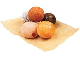 A variety of different Dunkin' Donuts munchkins on a knapkin.