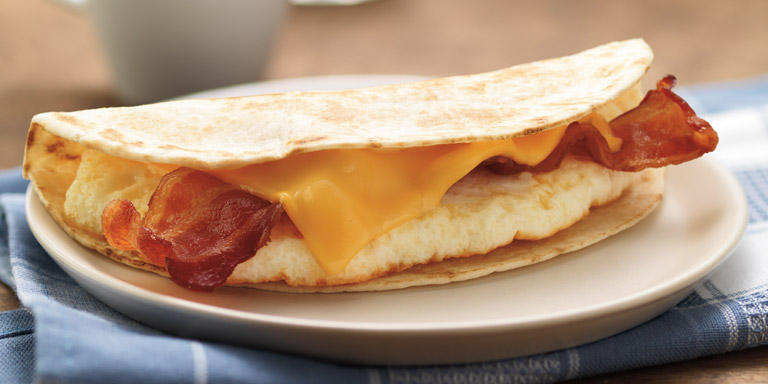 Dunkin' Donuts Bacon Egg & Cheese Wake-Up Wrap® on a plate.
