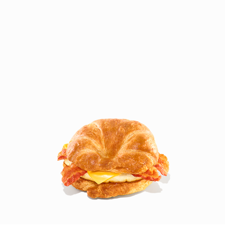 A bacon, egg, & cheese sandwich on a croissant